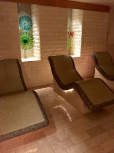 Heated stone chairs in spa